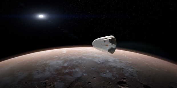 An artist rendering of SpaceX's Dragon spacecraft approaching Mars. Photo / SpaceX.