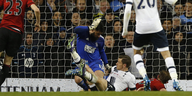 West Brom's Craig Dawson, on the ground right, scores an own goal through West Brom's goalkeeper Boaz Myhill legs. Photo / AP