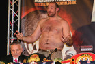 Tyson Fury faces the media bare chested during a press conference ahead of his fight with Wladimir Klitschko. Photo / Getty