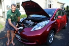 NO ORDINARY CAR: Chris Cresswell demonstrating how the Nissan Leaf is charged.PHOTO/STUART MUNRO