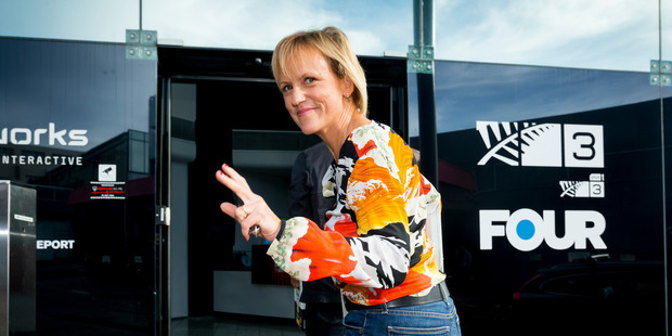 Loading TV 3 presenter Hilary Barry arrives at TV3 with a car boot full of celebration drinks. Photo / Dean Purcell