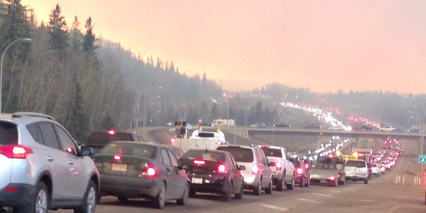 Queues of traffic on the highways as residents try to flee the Fort McMurray fire. Photo / Twitter