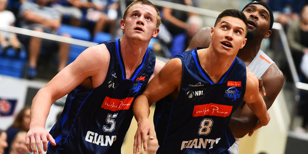 Giants players Finn Delany and Jarrod Kenny during their NBL Basketball game. Photo / Photosport