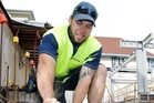 Havelock North second five-eighth Jesse Paewai on the job as an apprentice builder for Gemco Construction & Trades during a kitchen rebuild at Woodford House. Photo / Paul Taylor