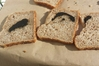 The black mass, believed to be burned dough, that a Waitangi couple found in their favourite loaf of bread.