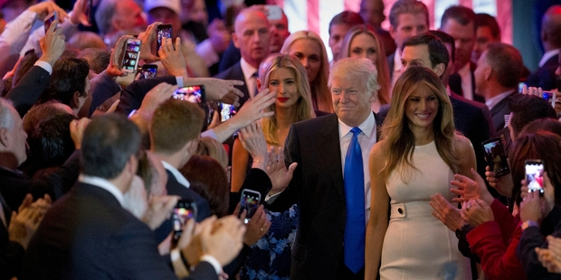 Loading Donald Trump is joined by his wife Melania (right) and daughter Ivanka as he greets supporters. Photo / AP