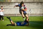 Rotoiti's Lorni Fisihoi rides a tackle in his team's defeat of Tauranga Sports at Tauranga Domain on Saturday. Photo / Andrew Warner