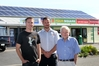 Bringing their neighbourhood towards rooftop solar-powered electricity independence are Cape View Four Square owner Michael Perc, Goldpower Solar Hawke's Bay director Sebastian Nilsson and building owner John Bridgeman.