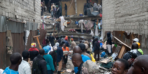 People help survivors retrieve their household items at the site of a building collapse in Nairobi, Kenya. Photo / AP