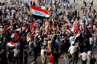 Supporters of Shia cleric Moqtada al-Sadr chant slogans calling for governmental reforms as they wave national flags before ending their sit-in inside Baghdad's highly fortified Green Zone. Photo / AP