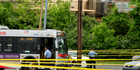 Police work a crime scene after authorities say a man attacked a bus driver, stole the bus, then struck and killed a man in Washington. Photo / AP