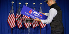 A worker for Republican presidential candidate Senator Ted Cruz, removes the campaign sign from the podium following primary night campaign event in Indianapolis. Photo / AP