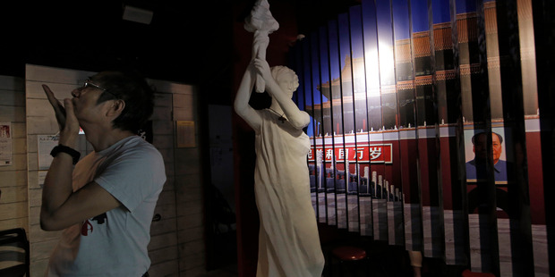A man looks at the exhibits in the June 4th Museum in Hong Kong. It is the world's only museum about the Chinese Government's brutal 1989 crackdown on student protesters in Beijing. Photo / AP