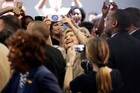 Democratic presidential candidate Hillary Clinton takes a selfie with supporters during a campaign event in Los Angeles. Photo / AP