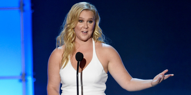 Amy Schumer isn't happy about the attitude of a fan. Photo/AP