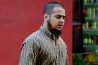 Imran Patel arrives at the Auckland District Court charged with threatening to kill in 2014. Photo / File
