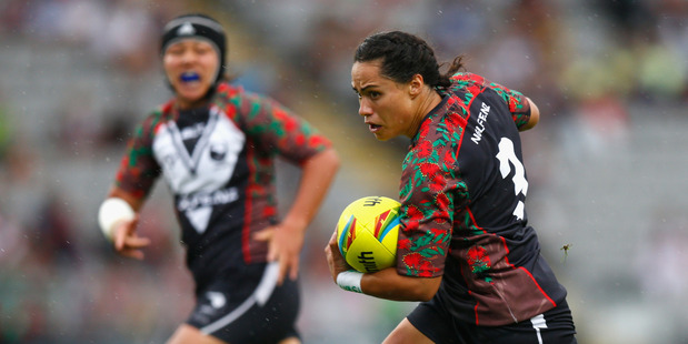 Hilda Peters on the charge for the Kiwi Ferns against the Jillaroos during the 2015 NRL Auckland Nines. Photo / Getty Images