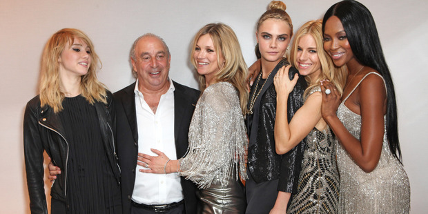 From left, Suki Waterhouse, Sir Philip Green, Kate Moss, Cara Delevingne, Sienna Miller and Naomi Campbell. Photo / Getty Images