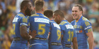 Eels centre Brad Takairangi celebrates with teammates after scoring a try against the Canberra Raiders. Photo/Getty