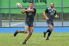 New Zealand All Blacks rugby player Sonny Bill Williams (L) takes part in a training session ahead of the Singapore Sevens rugby tournament. Photo / Getty Images