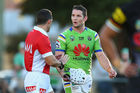 Referee Gavin Reynolds speaks to Jarrod Croker of the Raiders. Photo / Getty