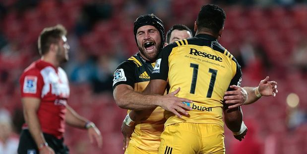 Hurricanes flanker Callum Gibbins congratulates Julian Savea after scoring against the Lions. Photo / Getty