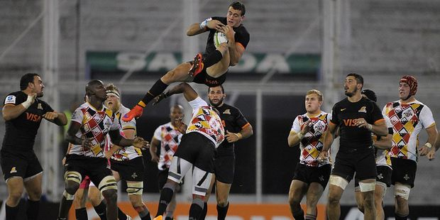 Jaguares' full back Emiliano Boffelli leaps over Kings fly-half Elgar Watts. Photo / Getty