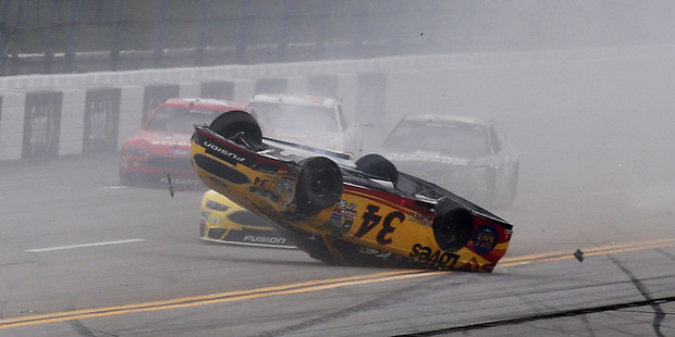 Chris Buescher, driver of the #34, has his car flipped onto its roof during the NASCAR Sprint Cup Series GEICO 500 at Talladega Superspeedway on Tuesday (NZT). Photo / Getty Images