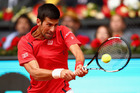 Novak Djokovic plays a backhand against Roberto Bautista Agut of Spain. Photo / Getty Images