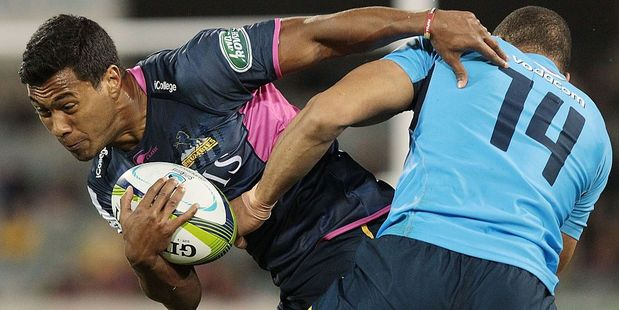 Aidan Toua of the Brumbies tries to evade the tackle of his Bulls opposite. Photo / Getty