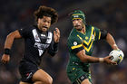 Jonathan Thurston of the Kangaroos is chased by Adam Blair of the Kiwis. Photo / Getty