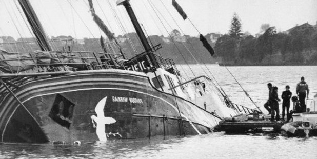 The partly-submerged Rainbow Warrior at Marsden Wharf on July 11, 1985. NZ Herald Archives