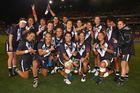 The Kiwi Ferns celebrate after victory against the Australian Jillaroos. Photo / Getty