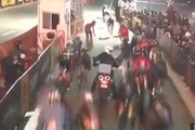 Cyclists competing in the Brooklyn leg of the Red Hook Crit were caught in a massive pileup when a motorbike stalled. Photo / Twitter.