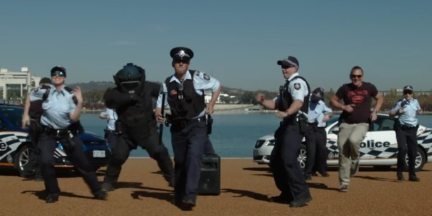 Loading Australian Federal Police get down feat. a man in a full bomb suit. Photo / AFP