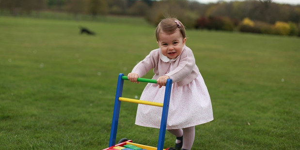 The Princess, who is one today, is pictured standing on her own two feet for the first time. Photo: The Royal Family/Facebook