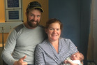 Liam Edwards and Jaimee Edwards with their five week old son Alexander. Photo / Supplied