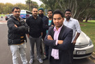 Leon Kang (at front, with other Uber drivers) says the app's new rate is a