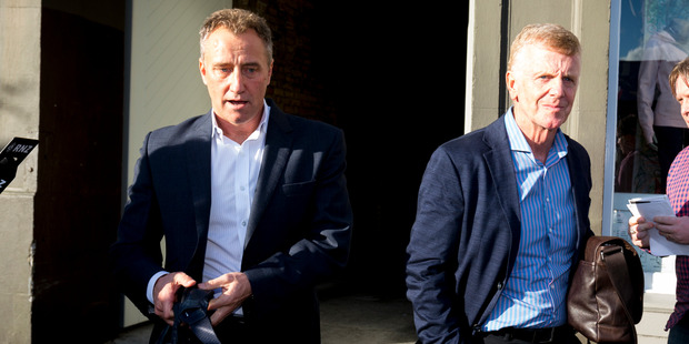 MediaWorks CEO Mark Weldon (L) leaves the Ponsonby Road office with members of the board. Photo / Dean Purcell