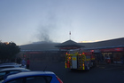 Fire crews attend to a fire at a bakery in the Flagstaff Shopping Centre in Hamilton. Photo / Niki Preston