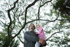 Craig Jones with his grandaughter Misha, 4, was planning to sit in a tree to stop it from being cut down. Photograph by John Borren.
