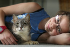 Danika Fisher, 10, with cat K Bear after it went missing for four years. Photo/John Borren