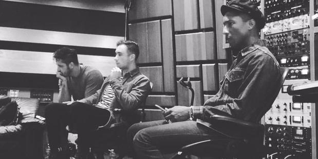 Photo of members of Six60 in the studio with Pharrell.