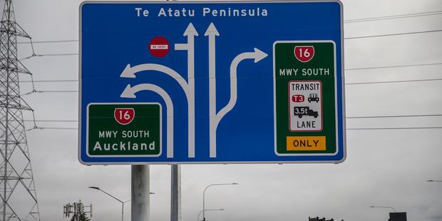 Motorway signs to Te Atatu Peninsula. Photo / Michael Craig