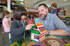 Principal Perry Rush helping student Lizzie Vermeij, 8, to build an icecream-stick house during Freedom Friday activities at Island Bay School in Wellington. Photo / Mark Mitchell