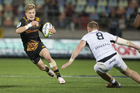 Damian McKenzie's build and skills are reminiscent of Mac Herewini. Photo / Photosport