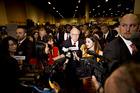 A scene from a love-fest: Warren Buffett faces the media scrum. Photo / Bloomberg
