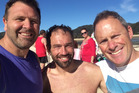 #Buythisbeachnz campaigner Duane Major, left, his friend Lincoln Churchill, middle, and brother-in-law Adam Gard'ner, right, enjoy Awaroa for the first time since the public purchase. Photo / Supplied