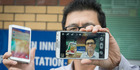 David Soh with the Samsung phone he bought on Trade Me which turned out to be stolen. Photo / Greg Bowker