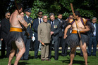 Indian President Pranab Mukherjee is accompanied by Mr Lewis Moeau during the Powhiri at Government House in Auckland. Photo / Greg Bowker